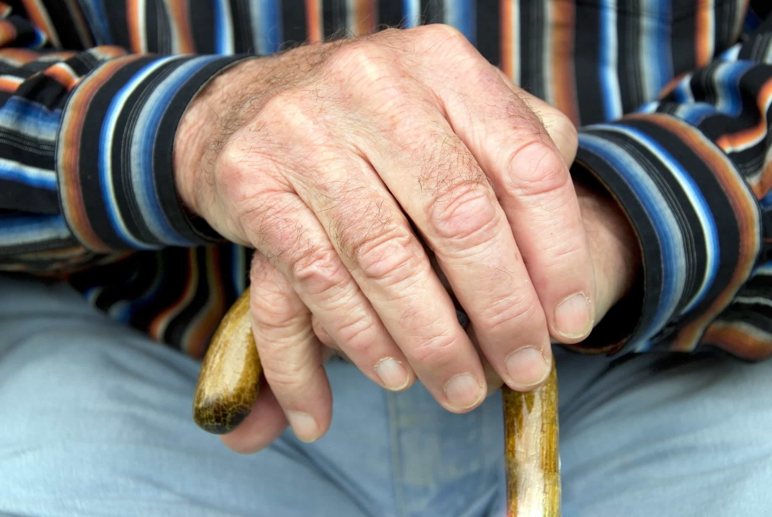 7669988 - hand of a senior man holding a cane
